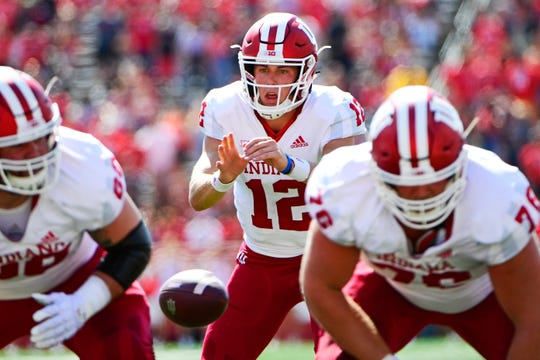 Peyton Ramsey #12 of the Indiana Hoosiers receives a snap against the Rutgers Scarlet Knights during the second quarter at HighPoint.com Stadium on September 29, 2018 in Piscataway, New Jersey.