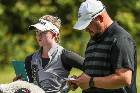 Westfield's Jocelyn Bruch and coach Trevor Neu prepare for Bruch to tee off at the 18th hole during IHSAA girls state golf finals at Prairie View Golf Club in Carmel, Ind., Saturday, Sept. 29, 2018. Bruch finished first individually, with a 1-under.