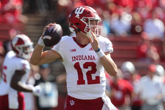 Indiana Hoosiers quarterback Peyton Ramsey (12) throws a pass during the first half of their game against the Rutgers Scarlet Knights at High Point Solutions Stadium.