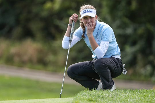 Maggie Schaffer, of Bishop Chatard, waits to putt to the 18th hole during IHSAA girls state golf finals at Prairie View Golf Club in Carmel, Ind., Saturday, Sept. 29, 2018.