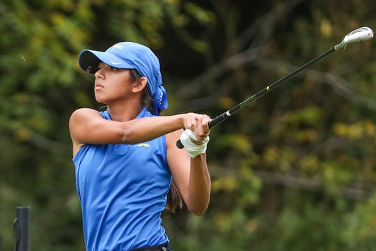 Carmel's Nina Hecht drives to the 18th green during IHSAA girls state golf finals at Prairie View Golf Club in Carmel, Ind., Saturday, Sept. 29, 2018. Hecht tied for sixth place individually, with a 7-over.