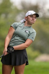 Evansville North's Katelyn Skinner reacts after chipping back onto the course at the 17th hole during IHSAA girls state golf finals at Prairie View Golf Club in Carmel, Ind., Saturday, Sept. 29, 2018. Evansville North was the overall champion. Skinner tied to finish second individually with a 5-over and was awarded the mental attitude award.