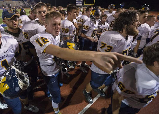 Mooresville High School senior Karson Goodman (12) sings the school song with his teammates for their fans after the game. Whiteland hosted Mooresville in IHSAA varsity football action, Friday, Sept. 28, 2018. Mooresville won 21-17.