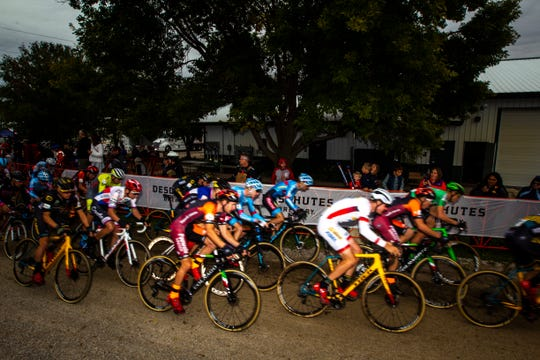 Competitors round the first turn along a straightaway out of the start line during the UCI Cyclo-Cross World Cup elite men's race on Saturday, Sept. 29, 2018, at the Johnson County Fairgrounds in Iowa City.
