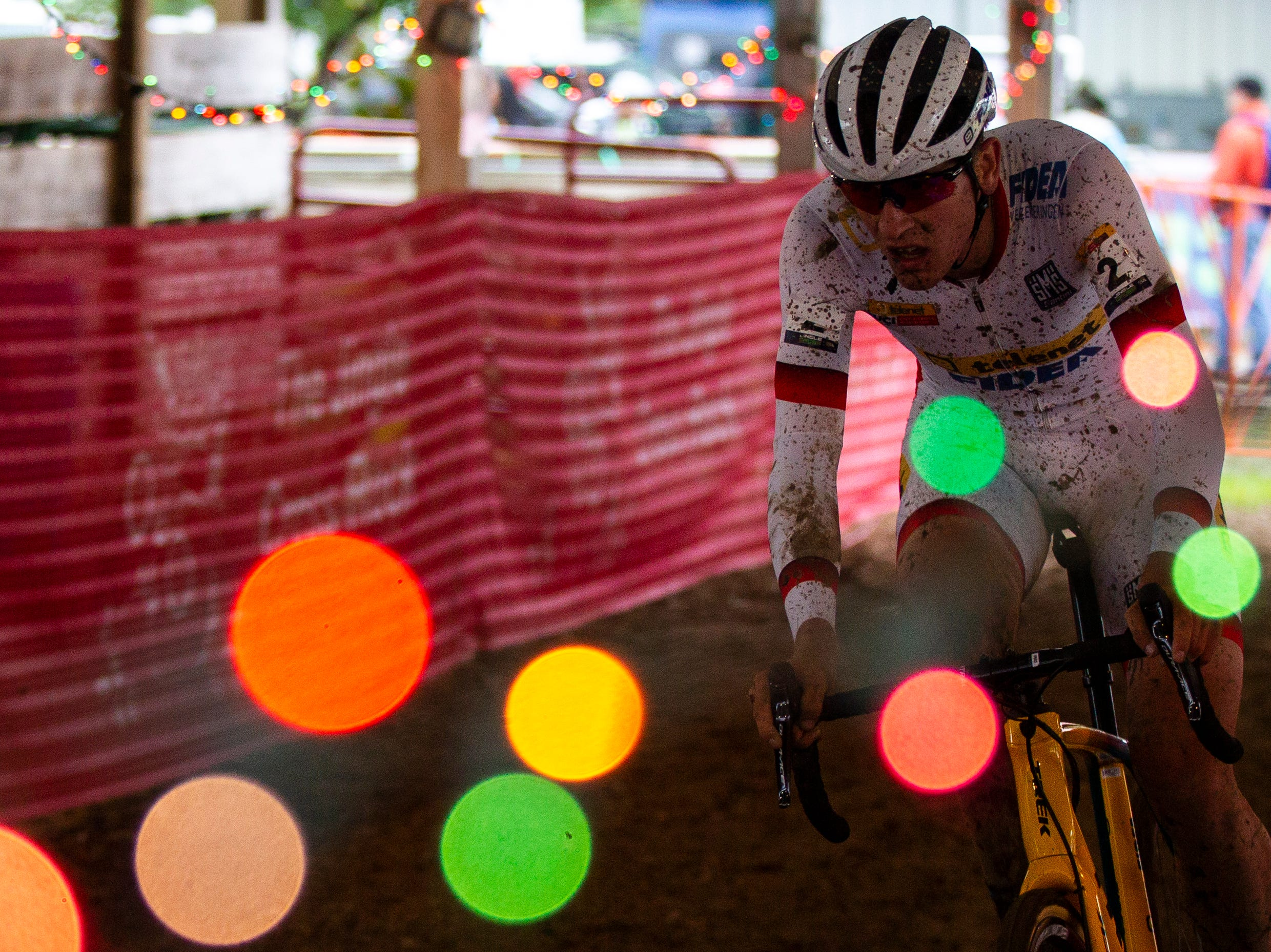 Toon Aerts of Belgium rides through a barn during the UCI Cyclo-Cross World Cup elite men's race on Saturday, Sept. 29, 2018, at the Johnson County Fairgrounds in Iowa City.