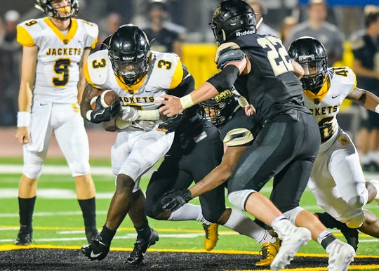 Starkville running back Rodrigues Clark (3) finds the going tough against the Northwest Rankin defense during game action Friday September 28th, 2018 in Flowood, MS (Bob Smith/For the Clarion Ledger)
