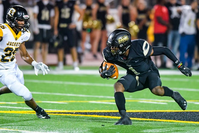 Northwest Rankin's Jarrian Jones (1) looks to escape Starkville's Lazavier Evans (25)  during game action Friday September 28th, 2018 in Flowood, MS (Bob Smith/For the Clarion Ledger)