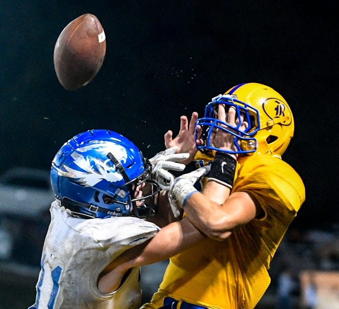 Waverly's Gavin Stanfield (11) shoves his hand into the face mask of Riverside wide receiver Jonathan Bowman (9) while Bowman tried to catch a pass during a TSSAA football game between Waverly High School and Riverside High School at Decatur County Middle School in Parsons, Tenn., on Friday, Sept. 28, 2018.
