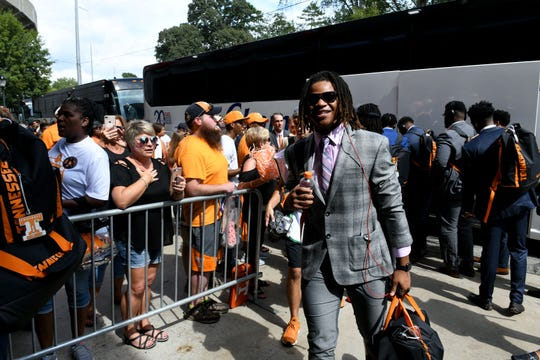 Tennessee players walk past about two dozen fans as they arrive at Sanford Stadium in Athens, GA  before their game against Georgia Saturday, September 29, 2018.