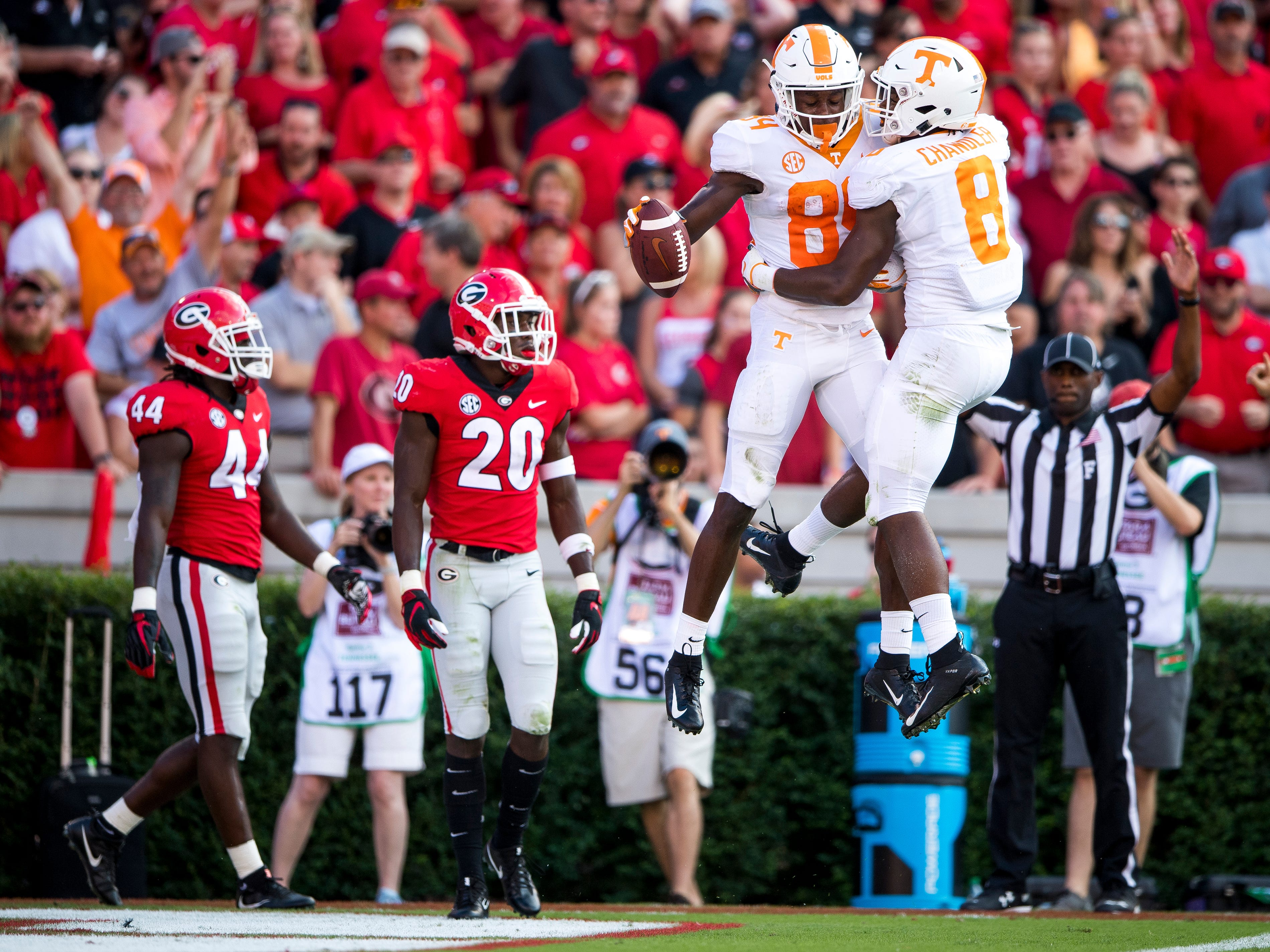 Tennessee wide receiver Josh Palmer (84) and Tennessee running back Ty Chandler (8) celebrate Palmer's touchdown during the Tennessee Volunteers' game against Georgia in Sanford Stadium in Athens, Ga., on Saturday, Sept. 29, 2018.