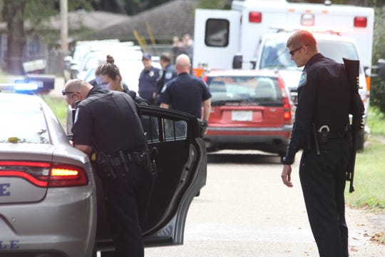 Officers respond to a shooting on Sandusky Road on Sept. 29, 2018. The victim was alive when he left the scene in an ambulance.