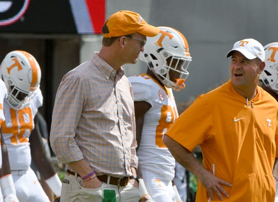 Peyton Manning talks to Tennessee Head Coach Jeremy Pruitt during warm-ups before the Georgia Saturday, September 29, 2018 at Sanford Stadium in Athens, GA.