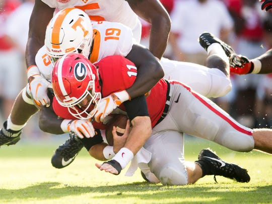 Tennessee linebacker Darrell Taylor (19) sacks Georgia quarterback Jake Fromm (11) during the Tennessee Volunteers' game against Georgia in Sanford Stadium in Athens, Ga., on Saturday, Sept. 29, 2018.