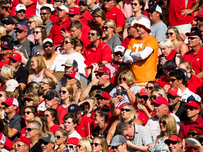 A lone Tennessee fan stands among Georgia fans in the stands during the Tennessee Volunteers' game against Georgia in Sanford Stadium in Athens, Ga., on Saturday, Sept. 29, 2018.