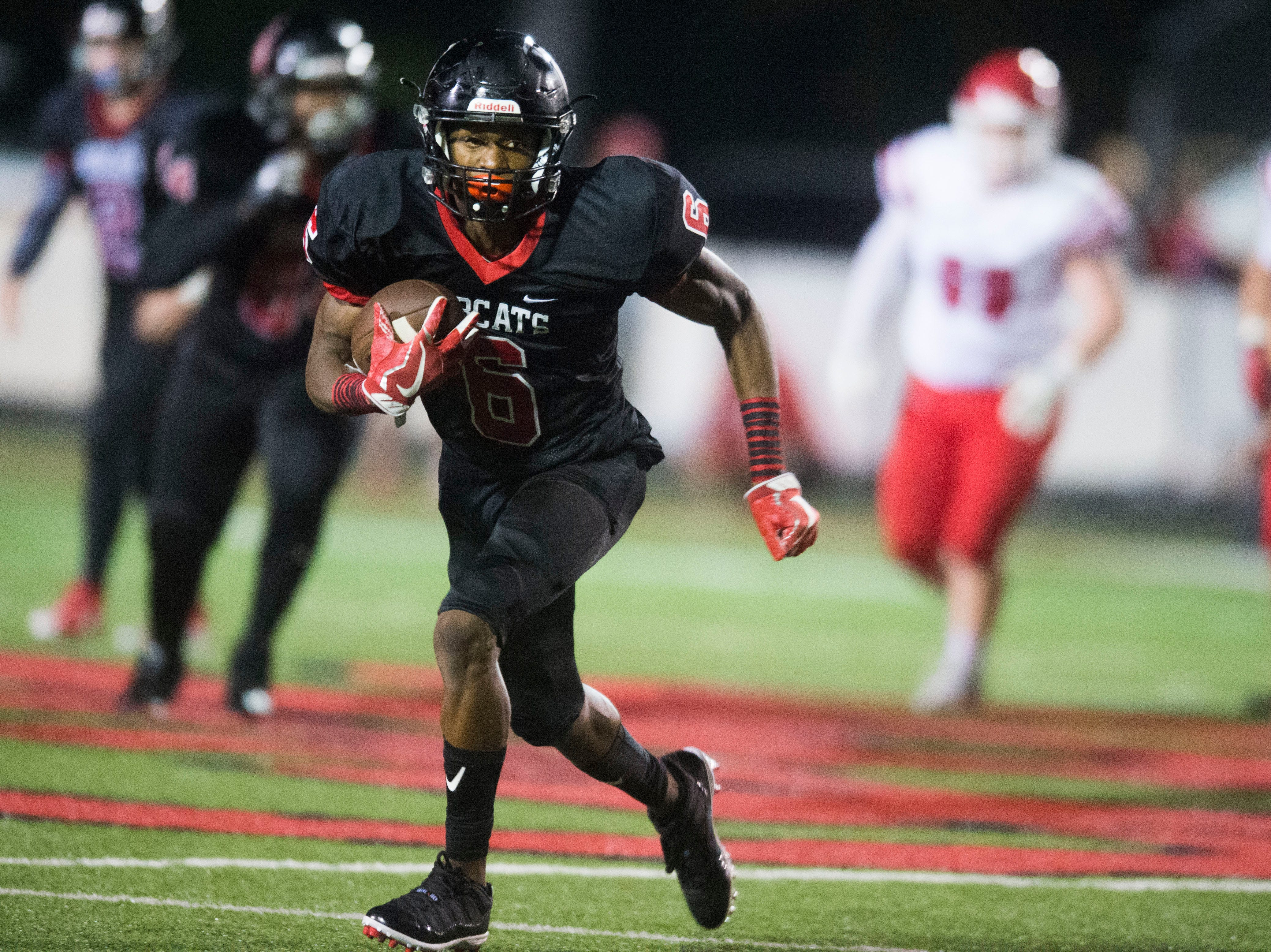Central's Demetrien Johnson (6) runs the ball during a high school football game between Central and Halls at Central Friday, Sept. 28, 2018. Central won 49-17.