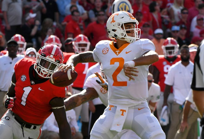 Tennessee quarterback Jarrett Guarantano (2) looks to pass in the first half against Georgia on Saturday.