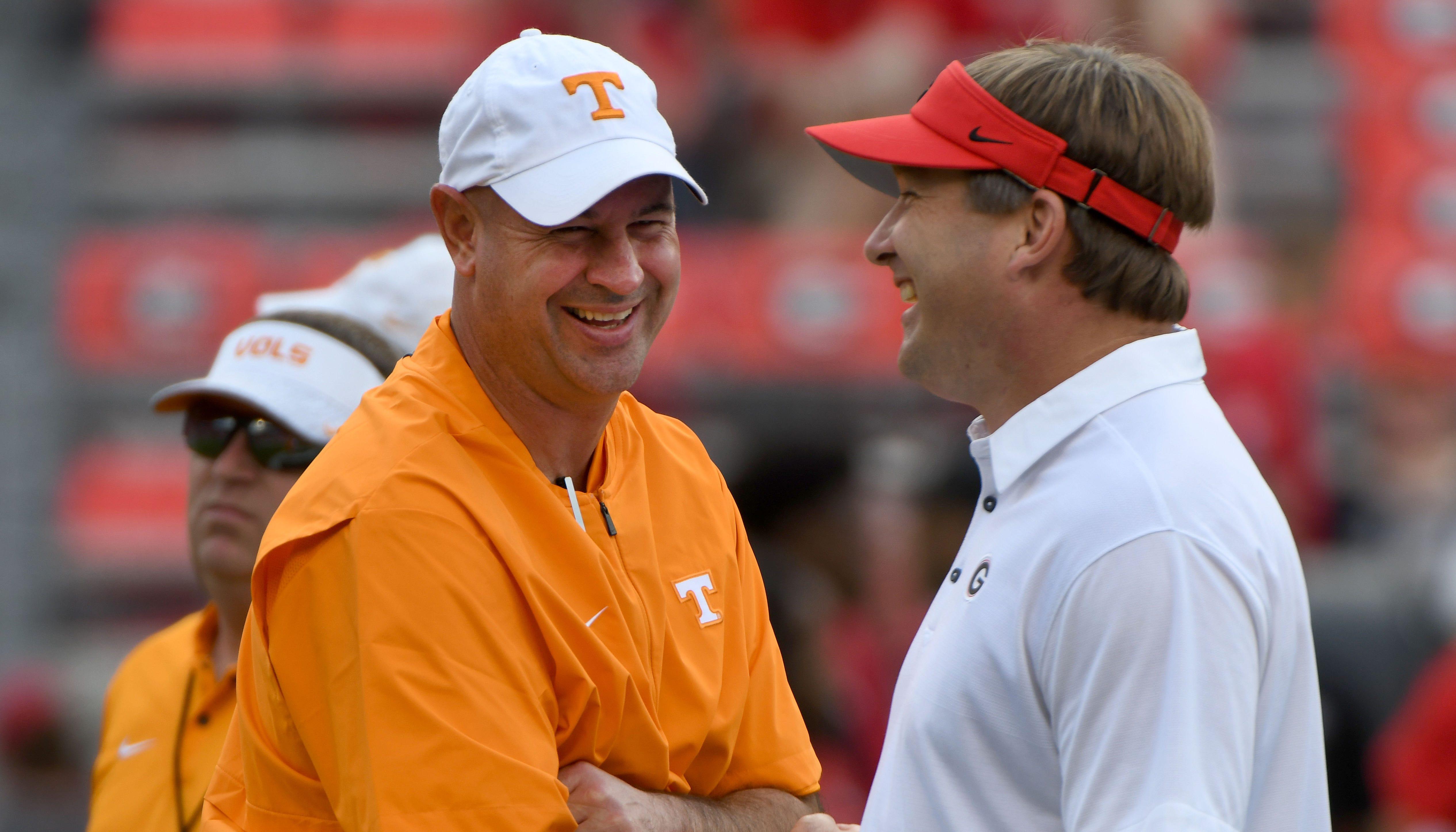 Tennessee Head Coach Jeremy Pruitt talks to...