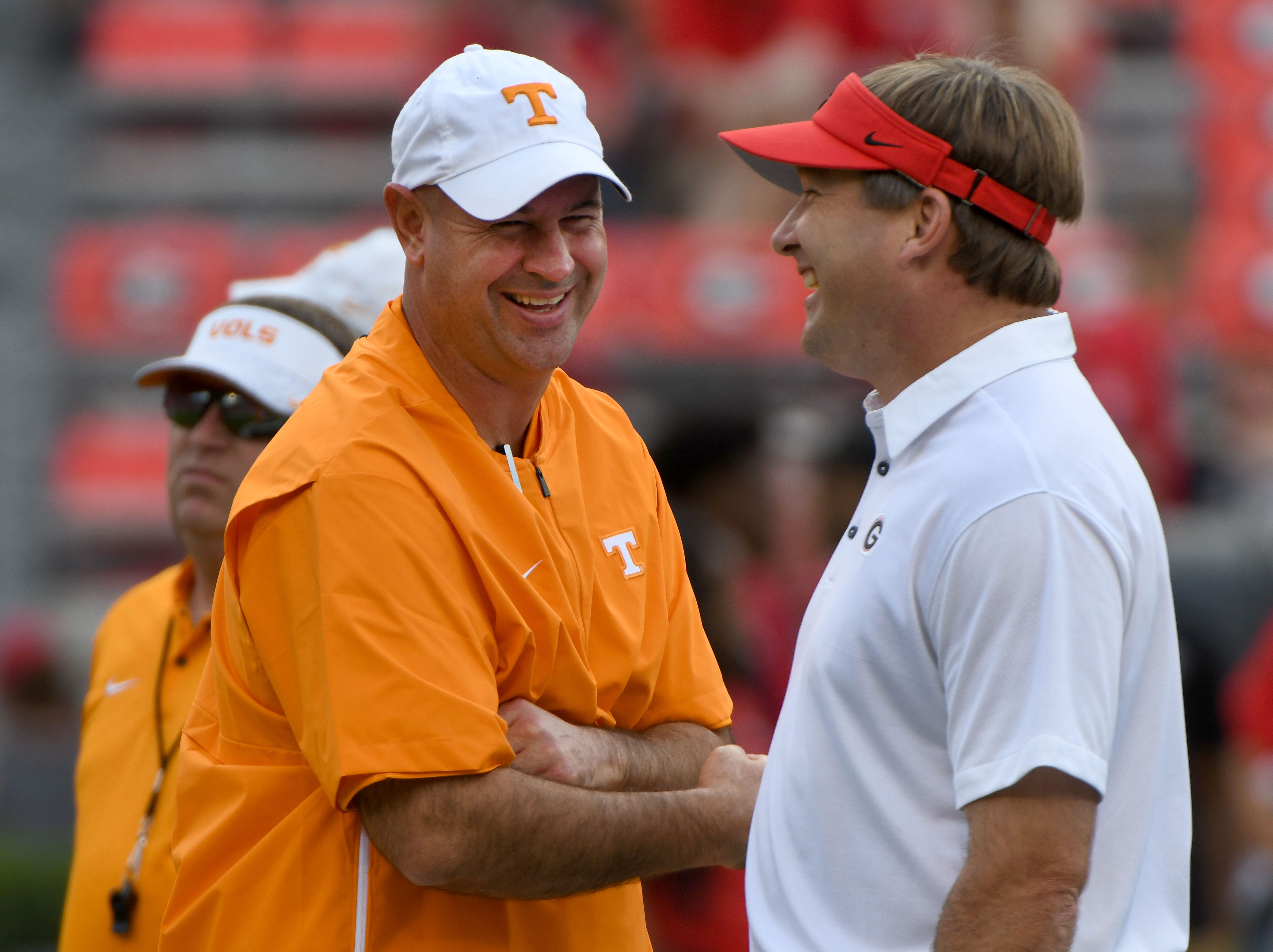 Tennessee Head Coach Jeremy Pruitt talks to Georgia Head Coach Kirby Smart during warm-ups before their game Saturday, September 29, 2018 at Sanford Stadium in Athens, GA.