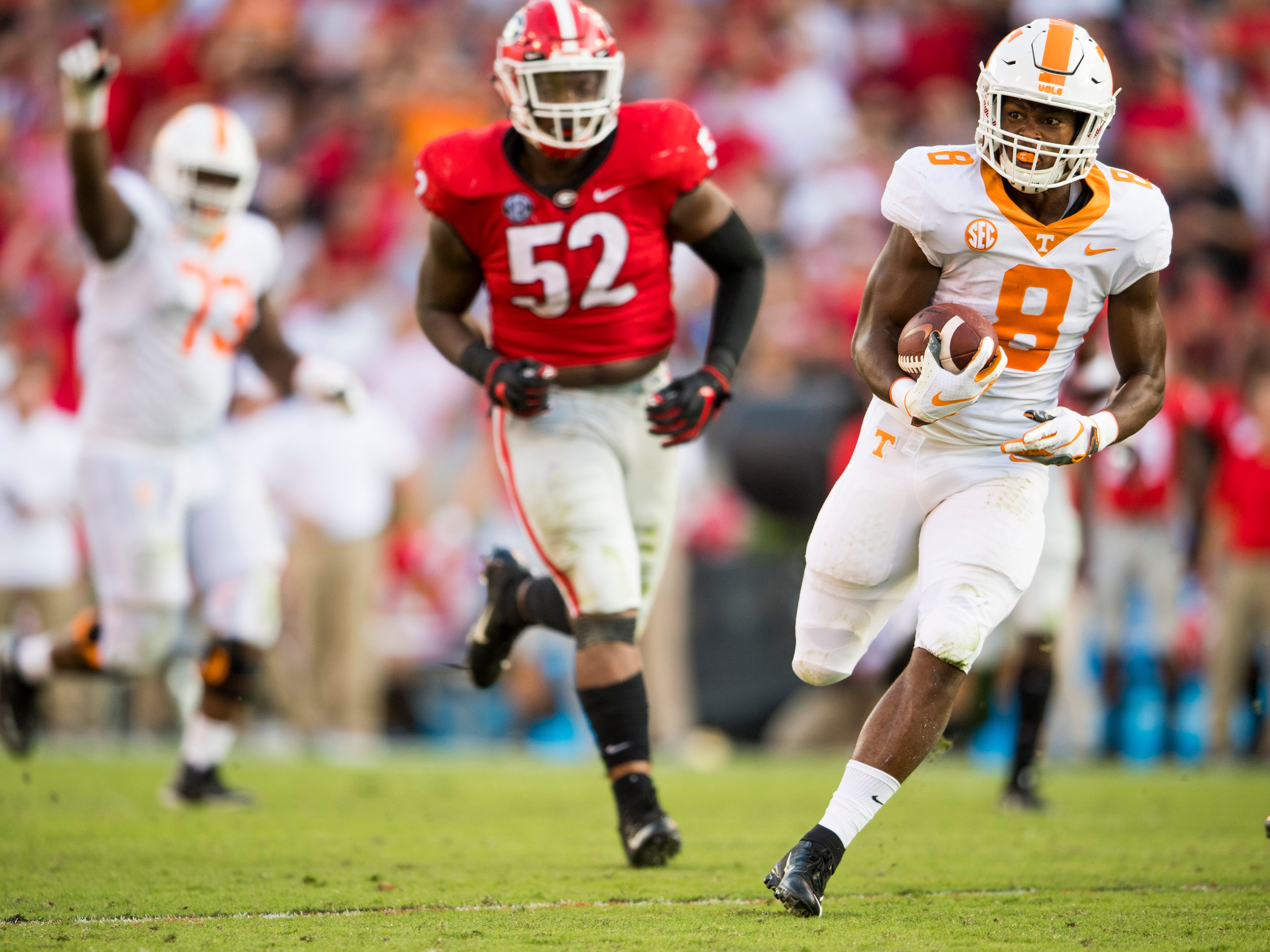 Tennessee running back Ty Chandler (8) runs for a touchdown during the Tennessee Volunteers' game against Georgia in Sanford Stadium in Athens, Ga., on Saturday, Sept. 29, 2018.