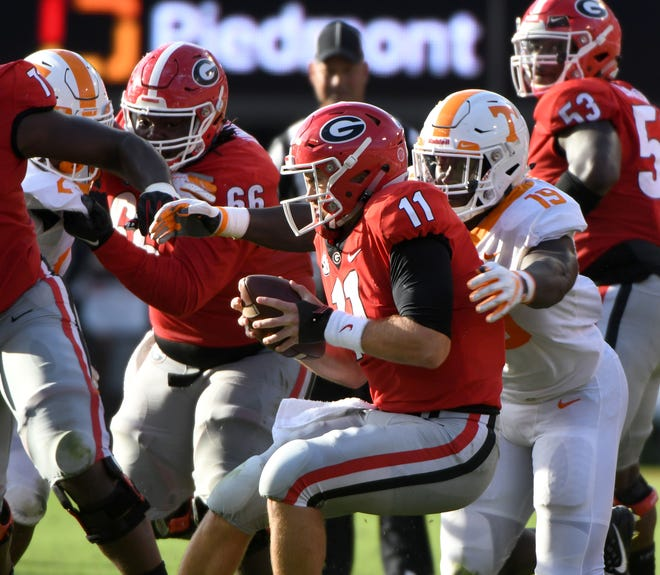 Tennessee linebacker Darrell Taylor (19) stops Georgia quarterback Jake Fromm (11) during second half action  Saturday, September 29, 2018 at Sanford Stadium in Athens, GA.