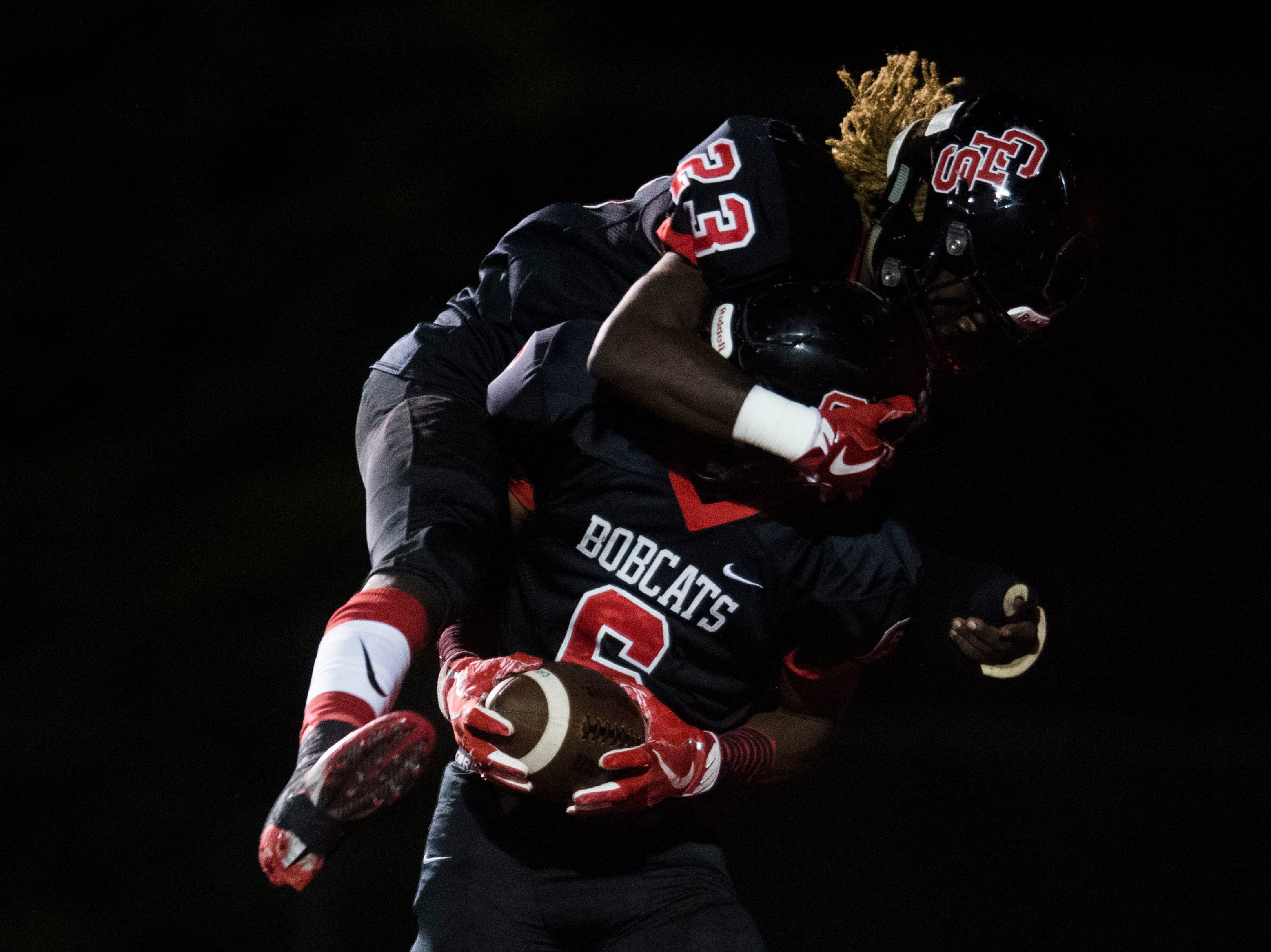 Central's Trey'sean Moore (23) celebrates Demetrien Johnson's (6) touchdown, before it was called back, during a high school football game between Central and Halls at Central Friday, Sept. 28, 2018. Central won 49-17.