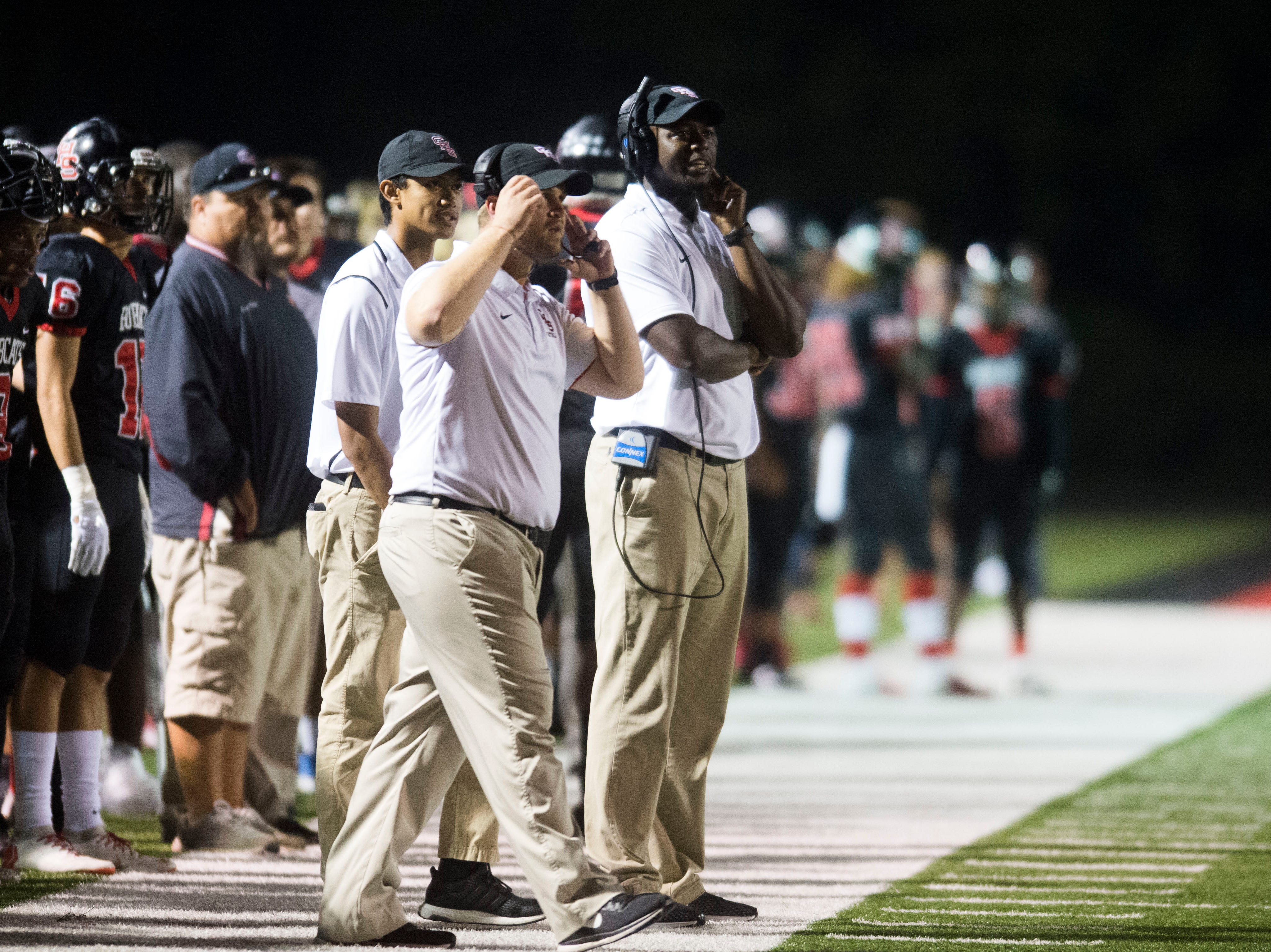 Central head coach Bryson Rosser, center, watches on the sidelines during a game against Halls at Central on Friday, Sept. 28, 2018. Central won 49-17.