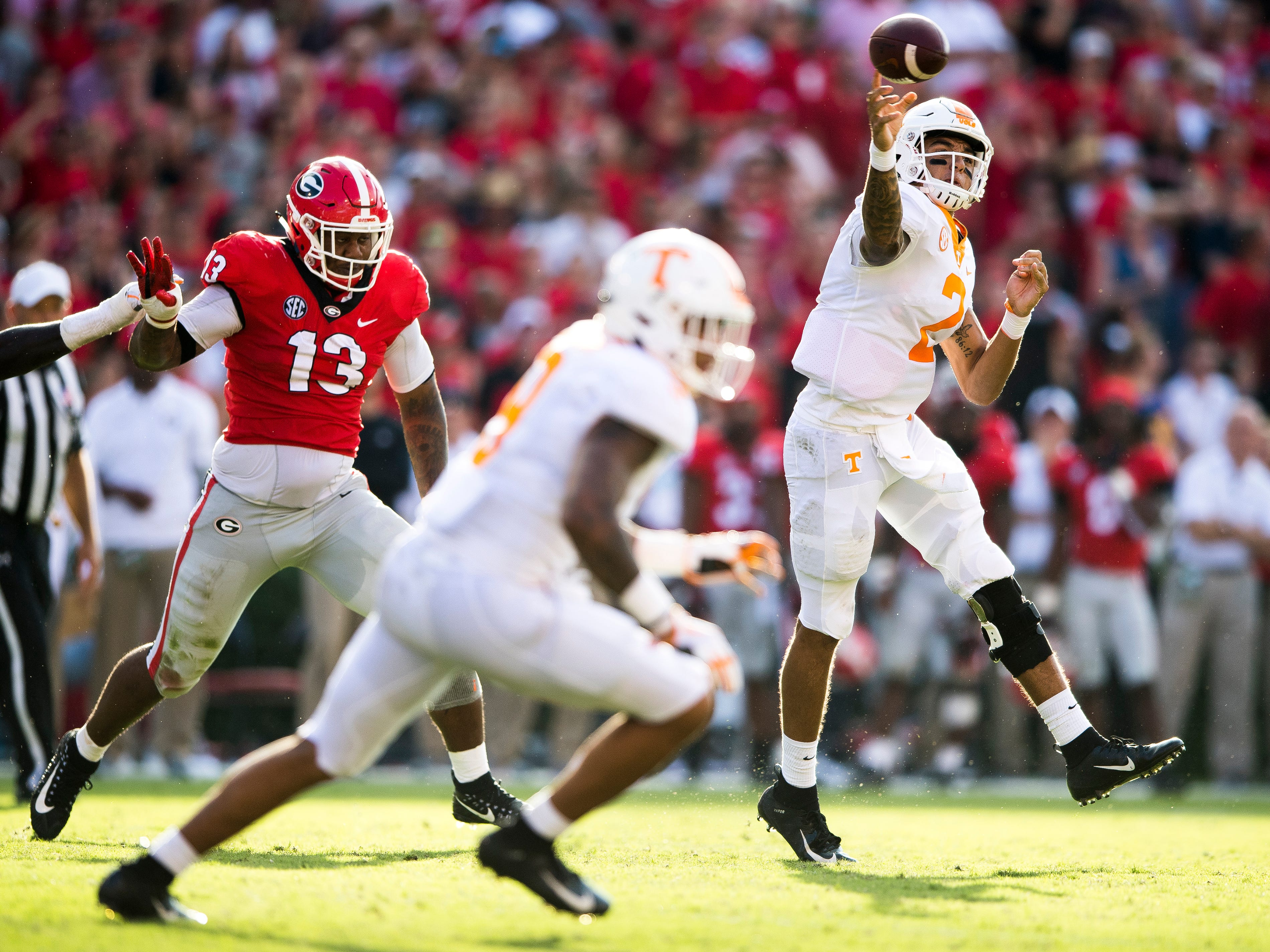 Tennessee quarterback Jarrett Guarantano (2) throws the ball during the Tennessee Volunteers' game against Georgia in Sanford Stadium in Athens, Ga., on Saturday, Sept. 29, 2018.