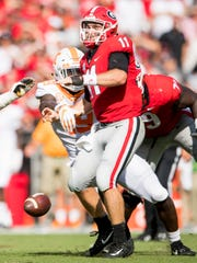 Tennessee linebacker Darrell Taylor (19) knocks the ball out of the hands of Georgia quarterback Jake Fromm (11) during the Tennessee Volunteers' game against Georgia in Sanford Stadium in Athens, Ga., on Saturday, Sept. 29, 2018.