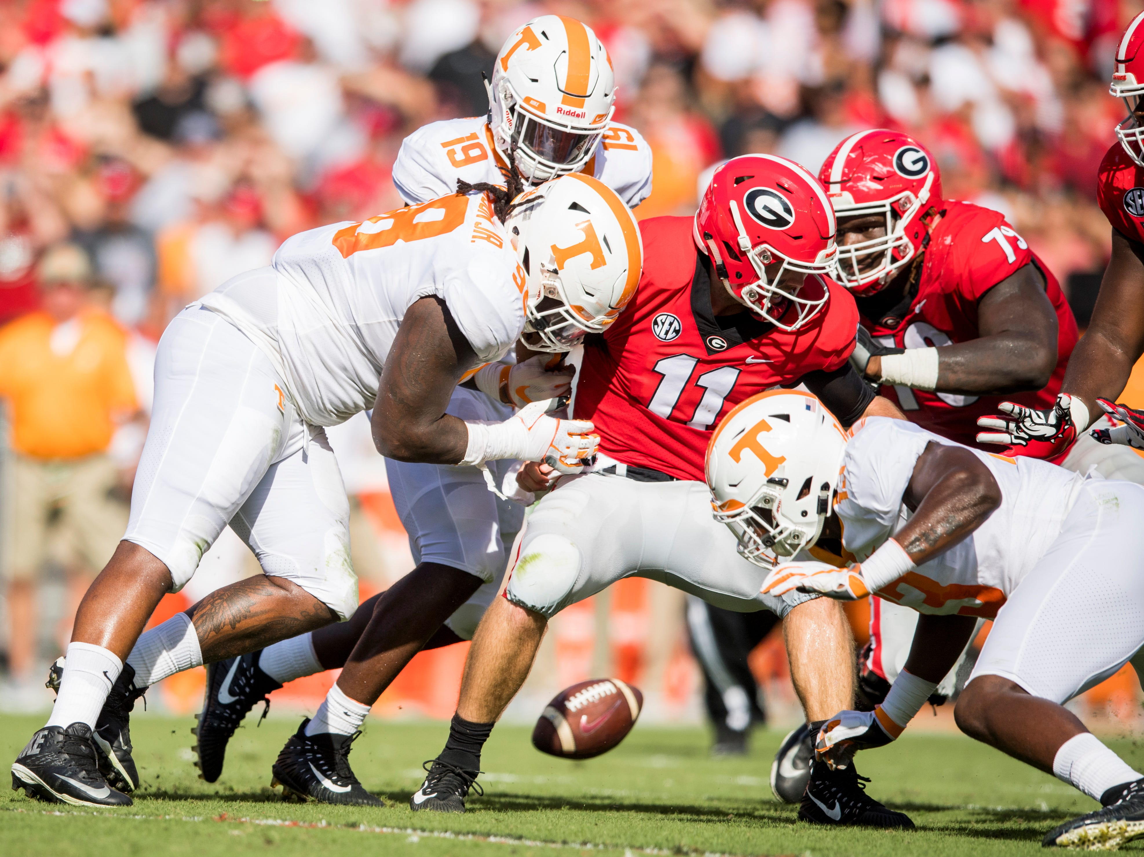 Georgia quarterback Jake Fromm (11) fumbles the ball during the Tennessee Volunteers' game against Georgia in Sanford Stadium in Athens, Ga., on Saturday, Sept. 29, 2018.