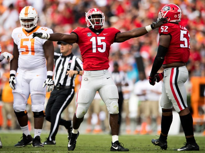 Georgia linebacker D'Andre Walker (15) celebrates a defensive play by the Bulldogs during the Tennessee Volunteers' game against Georgia in Sanford Stadium in Athens, Ga., on Saturday, Sept. 29, 2018.