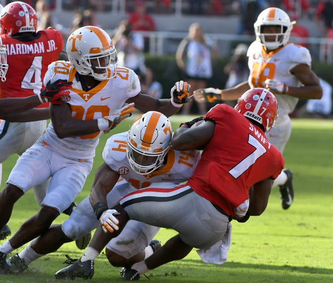 Tennessee linebacker Quart'e Sapp (14) stops Georgia running back D'Andre Swift (7) during second-half action Saturday.