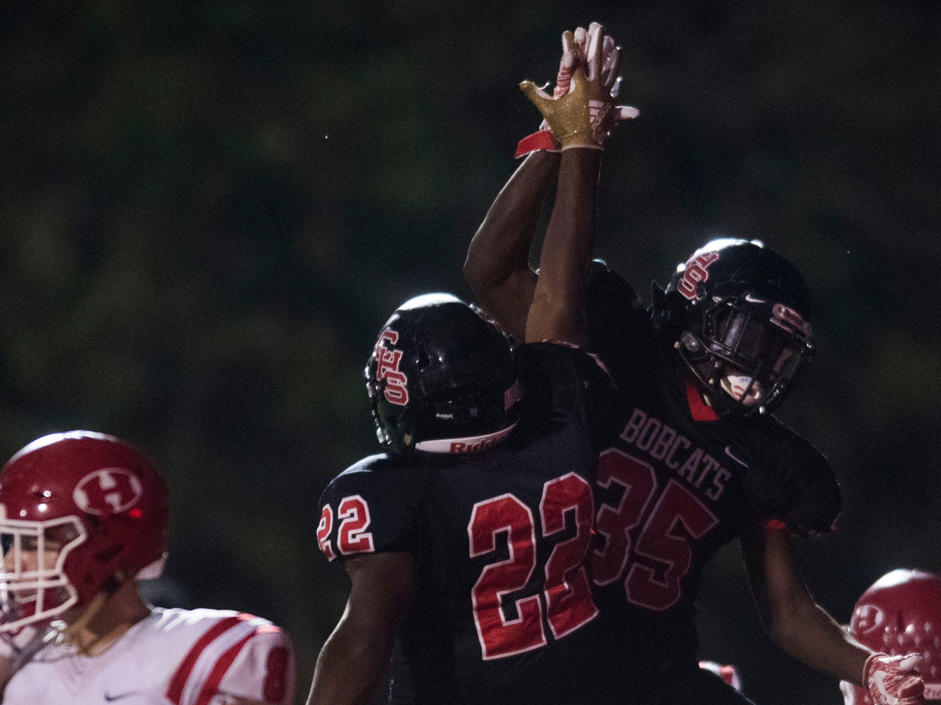Central's Jason Merritts (35) celebrates teammate Devone Moss' touch down during a high school football game between Central and Halls at Central Friday, Sept. 28, 2018. Central won 49-17.
