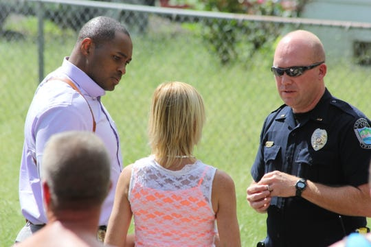 Officers speak with a woman following a shooting on Sandusky Road on Sept. 29, 2018. The shooting happened just before 1 p.m.