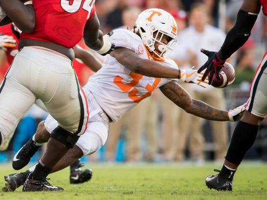 Tennessee running back Jeremy Banks (33) fumbles the ball during the Tennessee Volunteers' game against Georgia in Sanford Stadium in Athens, Ga., on Saturday, Sept. 29, 2018.