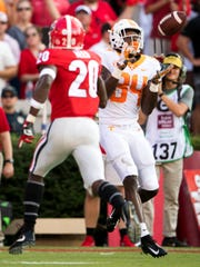 Tennessee wide receiver Josh Palmer (84) makes a catch en route to a touchdown during the Tennessee Volunteers' game against Georgia in Sanford Stadium in Athens, Ga., on Saturday, Sept. 29, 2018.