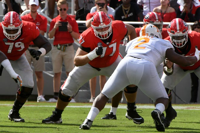 Georgia offensive lineman Cade Mays (77) blocks against Tennessee during a game Sept. 29.