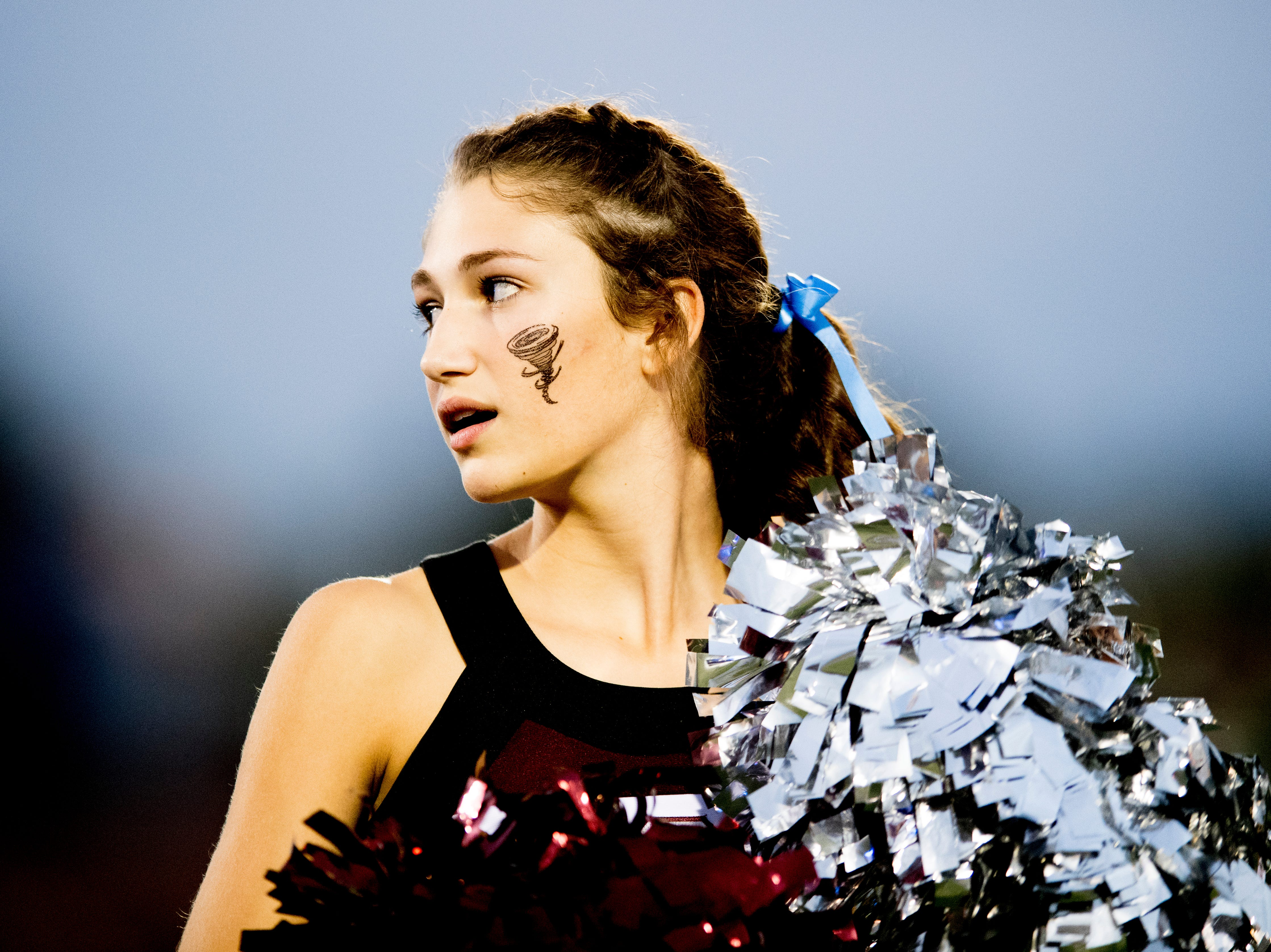 An Alcoa cheerleader watches the game during a game between Alcoa and Northview at Alcoa High School in Alcoa, Tennessee on Friday, September 28, 2018.