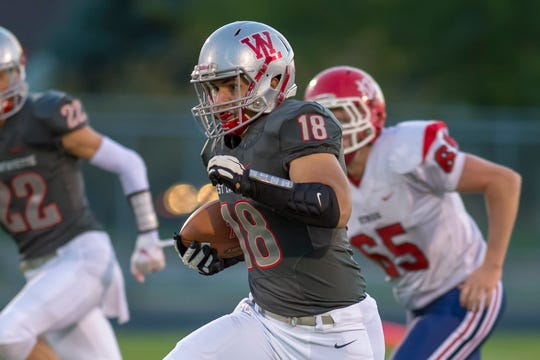 Sage Hood breaks a long run during West Lafayette's 57-7 victory over Lewis Cass.