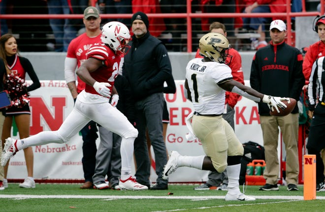 Purdue running back D.J. Knox (1) scores a touchdown ahead of Nebraska defensive back Aaron Williams (24) during the first half of an NCAA college football game in Lincoln, Neb., Saturday, Sept. 29, 2018. (AP Photo/Nati Harnik)