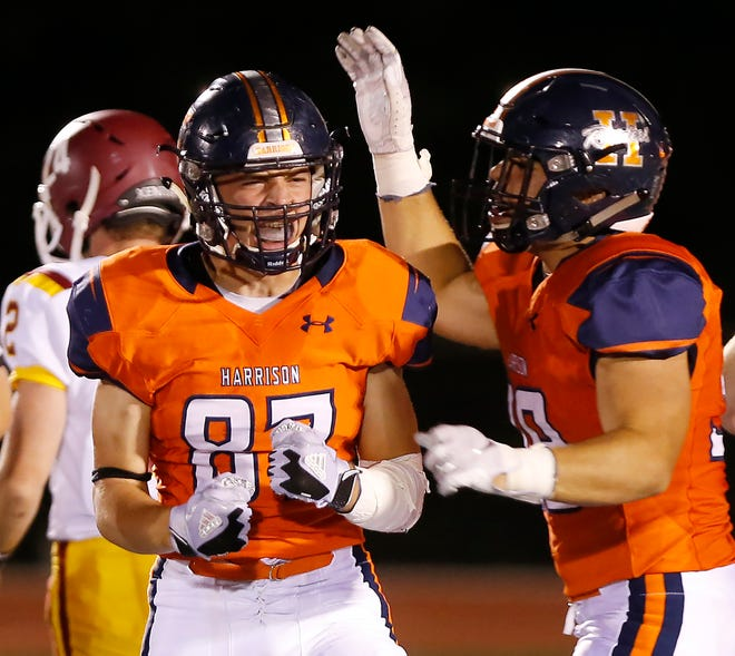 Jacob Cain, left, of Harrison lets out a scream after sacking McCutcheon quarterback Peyton Williams with 11:43 remaining Friday, September 28, 2018, in West Lafayette. Harrison defeated county rival McCutcheon 17-7 and in the process reclaimed The Sword.
