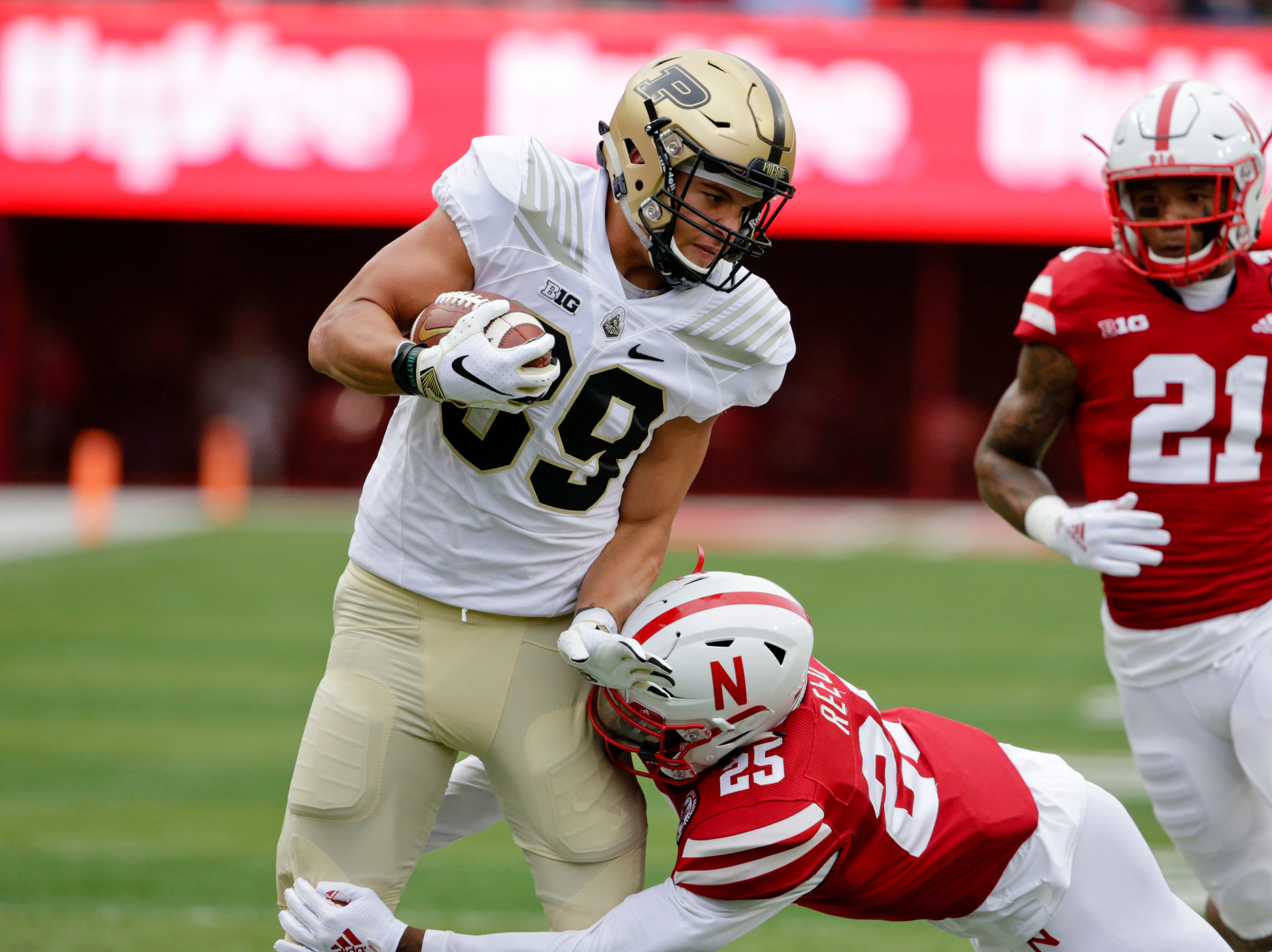 Purdue tight end Brycen Hopkins (89) is tackled by Nebraska defensive back Antonio Reed (25) during the first half of an NCAA college football game in Lincoln, Neb., Saturday, Sept. 29, 2018. (AP Photo/Nati Harnik)