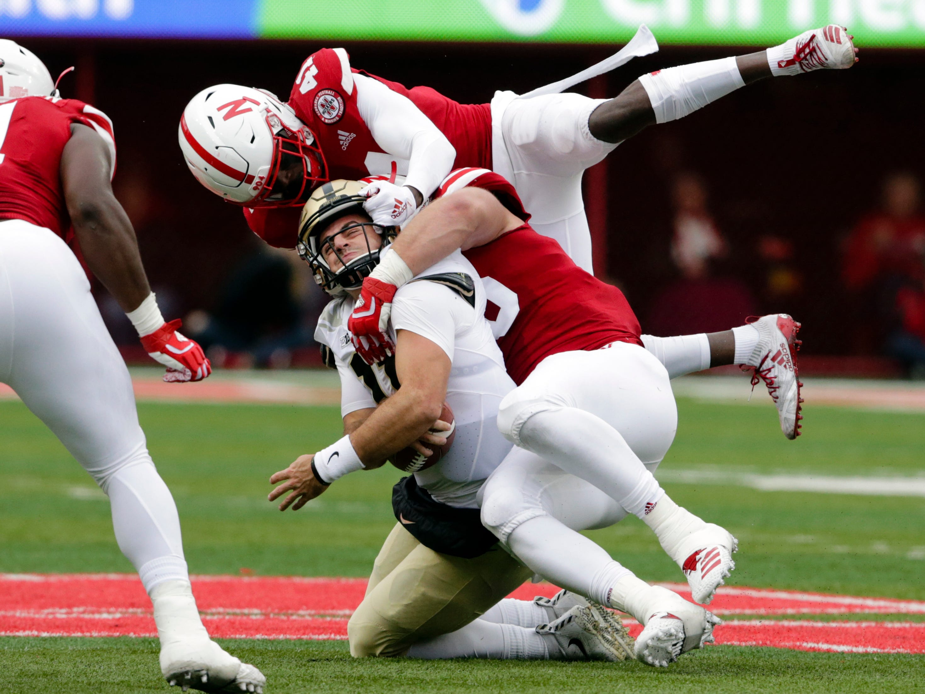 Purdue quarterback David Blough (11) is sacked by Nebraska defensive back Deontai Williams (41) and defensive lineman Ben Stille (95) during the first half of an NCAA college football game in Lincoln, Neb., Saturday, Sept. 29, 2018. (AP Photo/Nati Harnik)