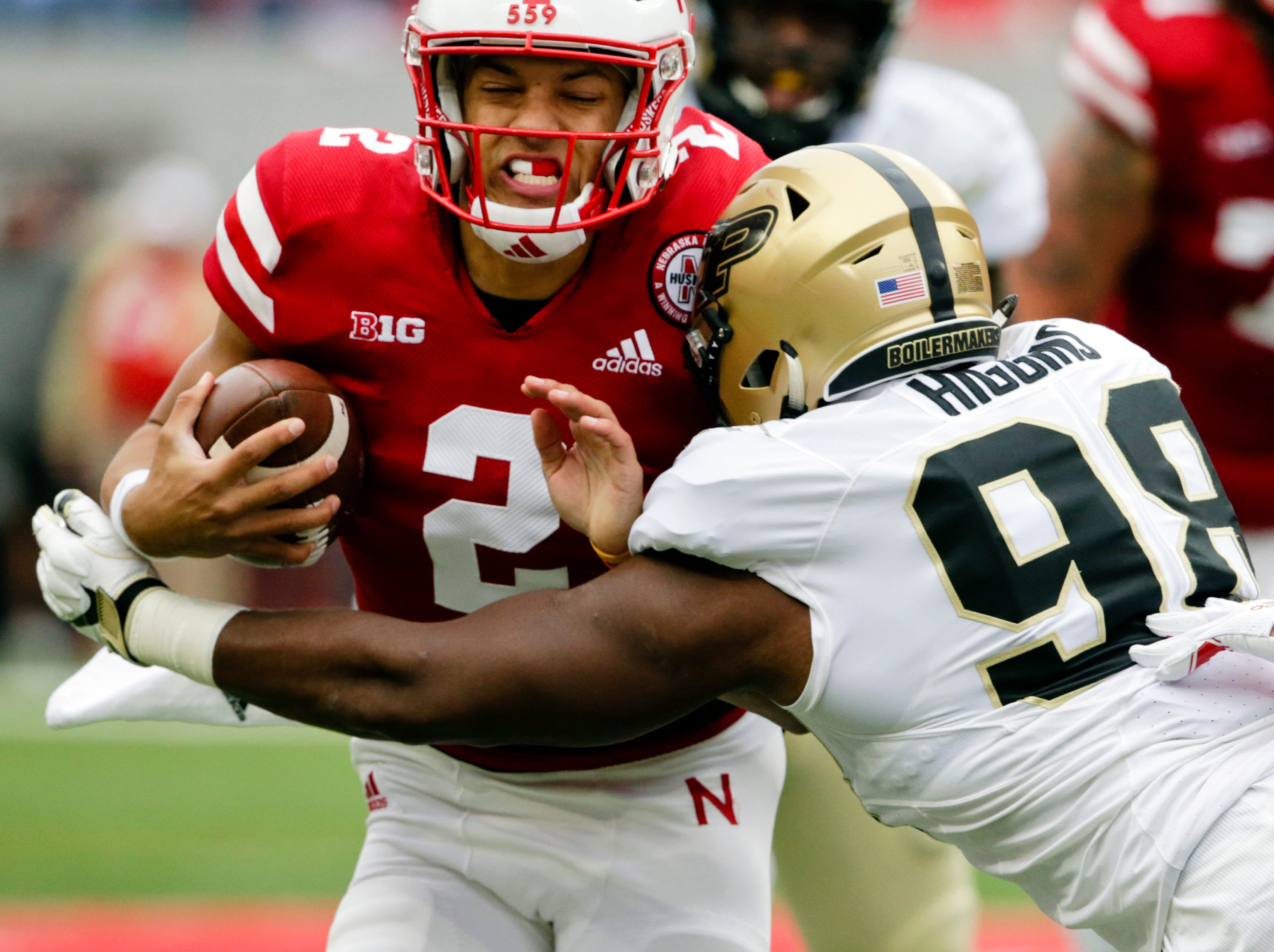 Purdue defensive end Kai Higgins (98) tackles Nebraska quarterback Adrian Martinez (2) during the first half of an NCAA college football game in Lincoln, Neb., Saturday, Sept. 29, 2018. (AP Photo/Nati Harnik)