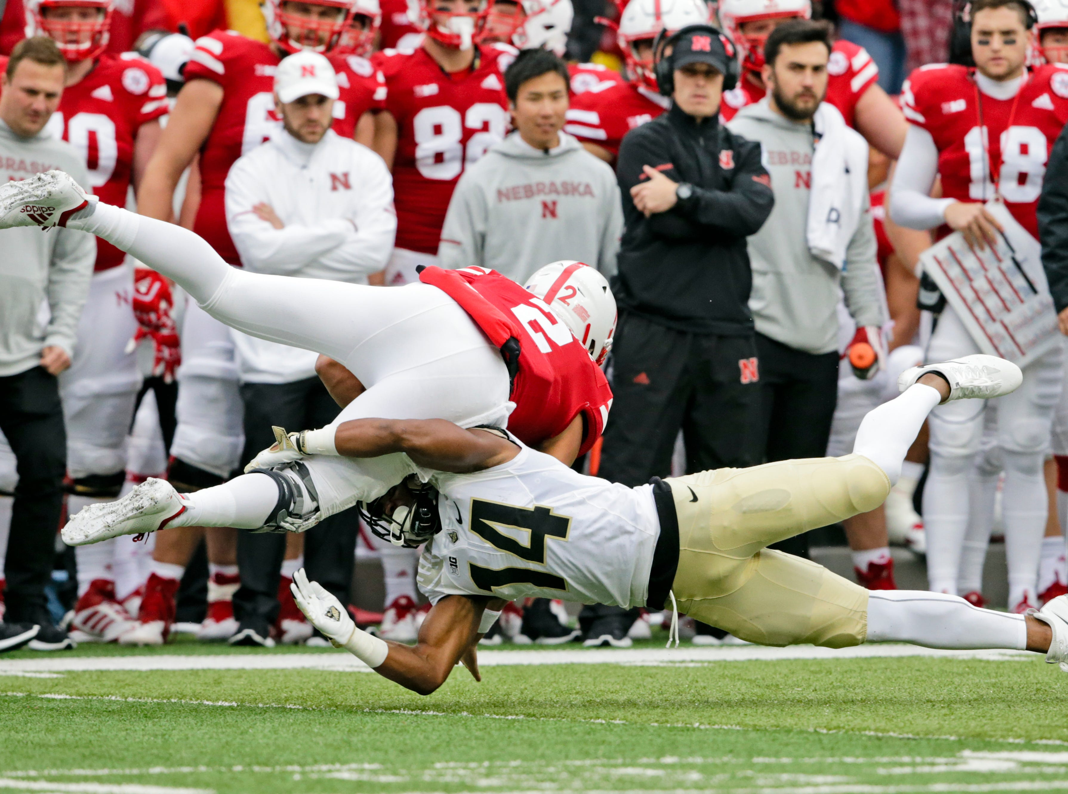 Purdue cornerback Antonio Blackmon (14) tackles Nebraska quarterback Adrian Martinez (2) during the first half of an NCAA college football game in Lincoln, Neb., Saturday, Sept. 29, 2018. (AP Photo/Nati Harnik)