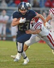 Daniel Roach breaks a tackle against Twin Lakes last season.