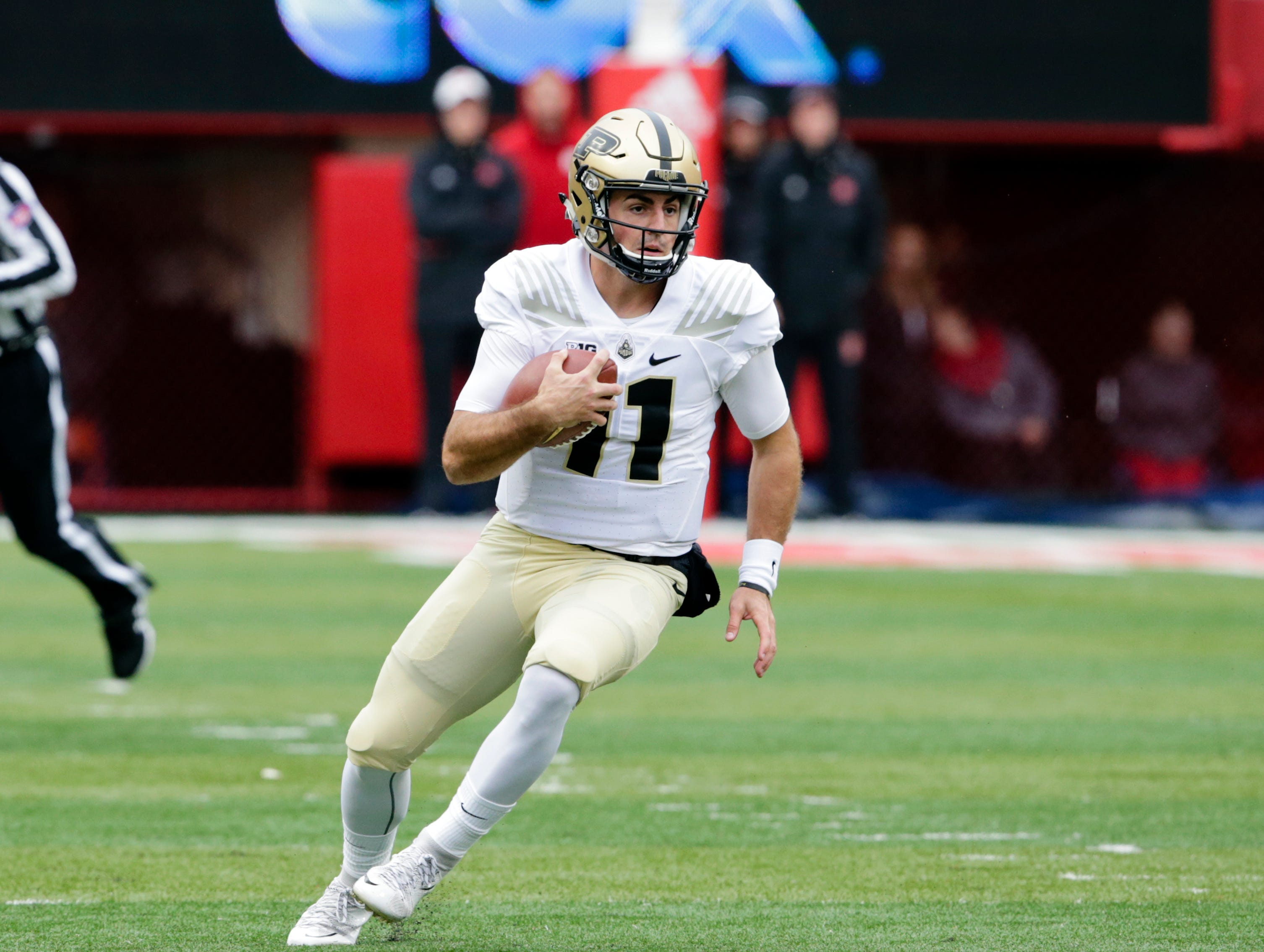 Purdue quarterback David Blough (11) runs with the ball during the first half of an NCAA college football game against Nebraska in Lincoln, Neb., Saturday, Sept. 29, 2018. (AP Photo/Nati Harnik)