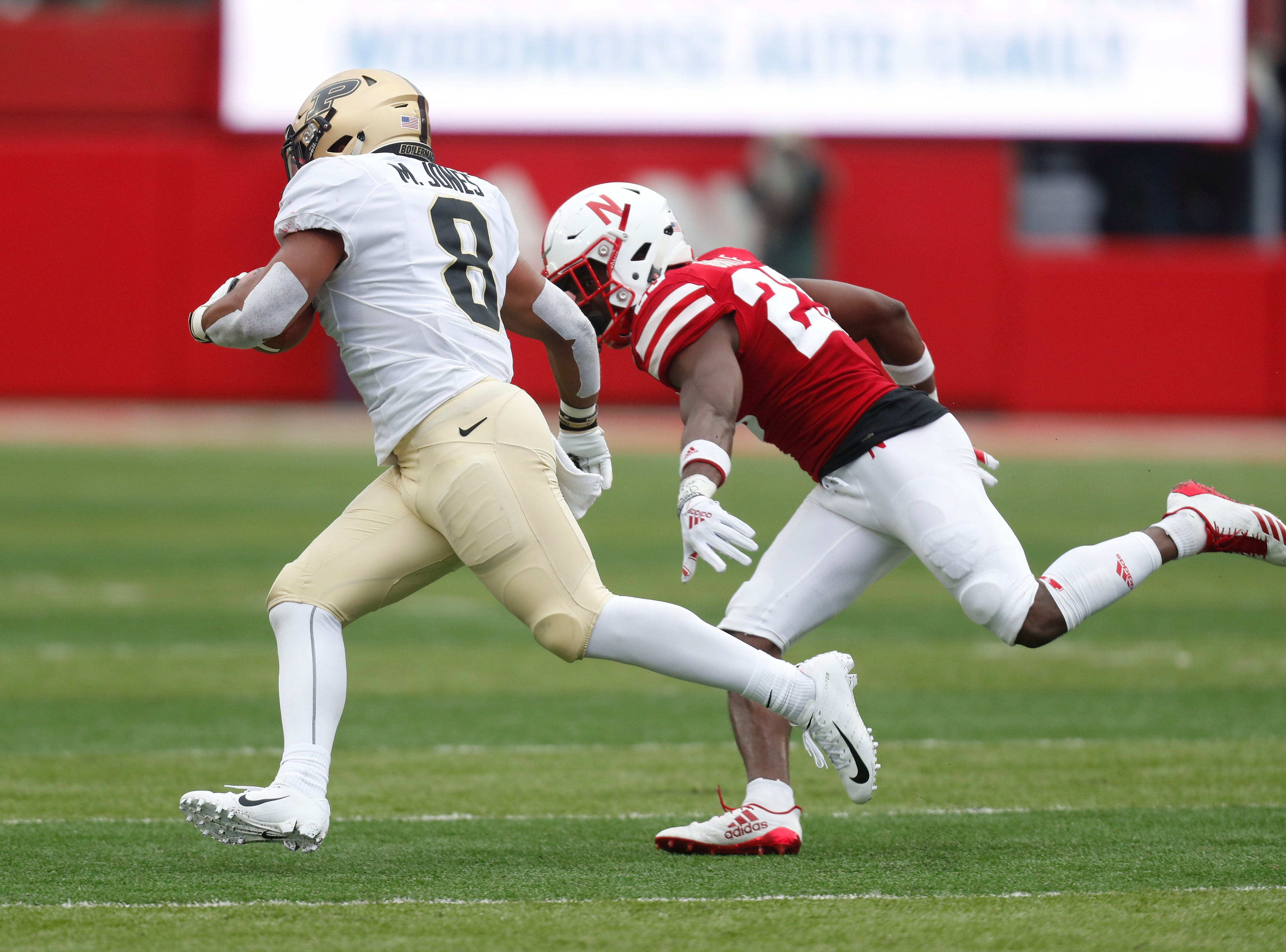 Sep 29, 2018; Lincoln, NE, USA; Purdue Boilermakers running back Markell Jones (8) gets away from Nebraska Cornhuskers cornerback Decaprio Bootle (23) in the first half at Memorial Stadium. Mandatory Credit: Bruce Thorson-USA TODAY Sports