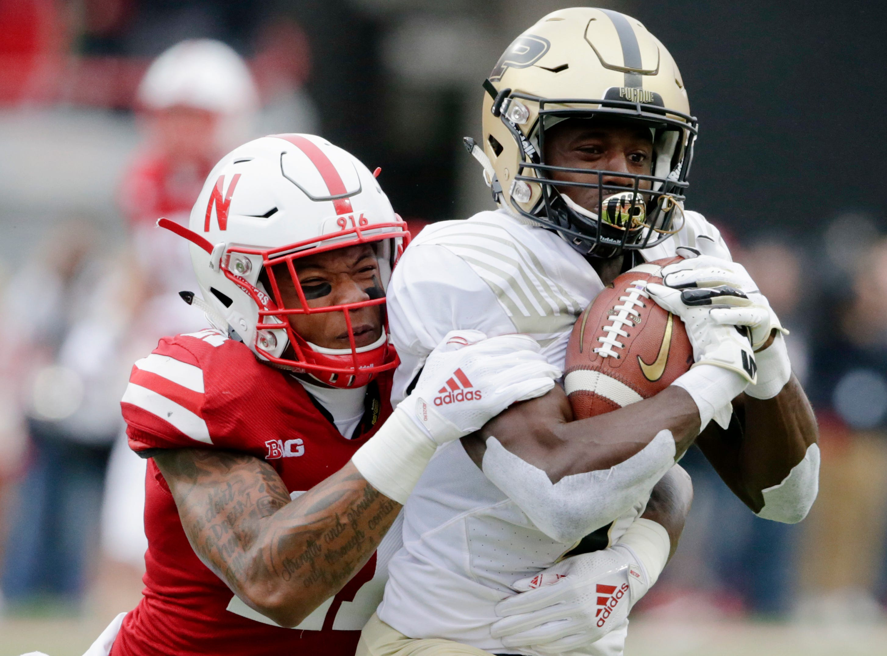 Purdue wide receiver Isaac Zico (7) is tackled by Nebraska defensive back Lamar Jackson (21) during the first half of an NCAA college football game in Lincoln, Neb., Saturday, Sept. 29, 2018. (AP Photo/Nati Harnik)