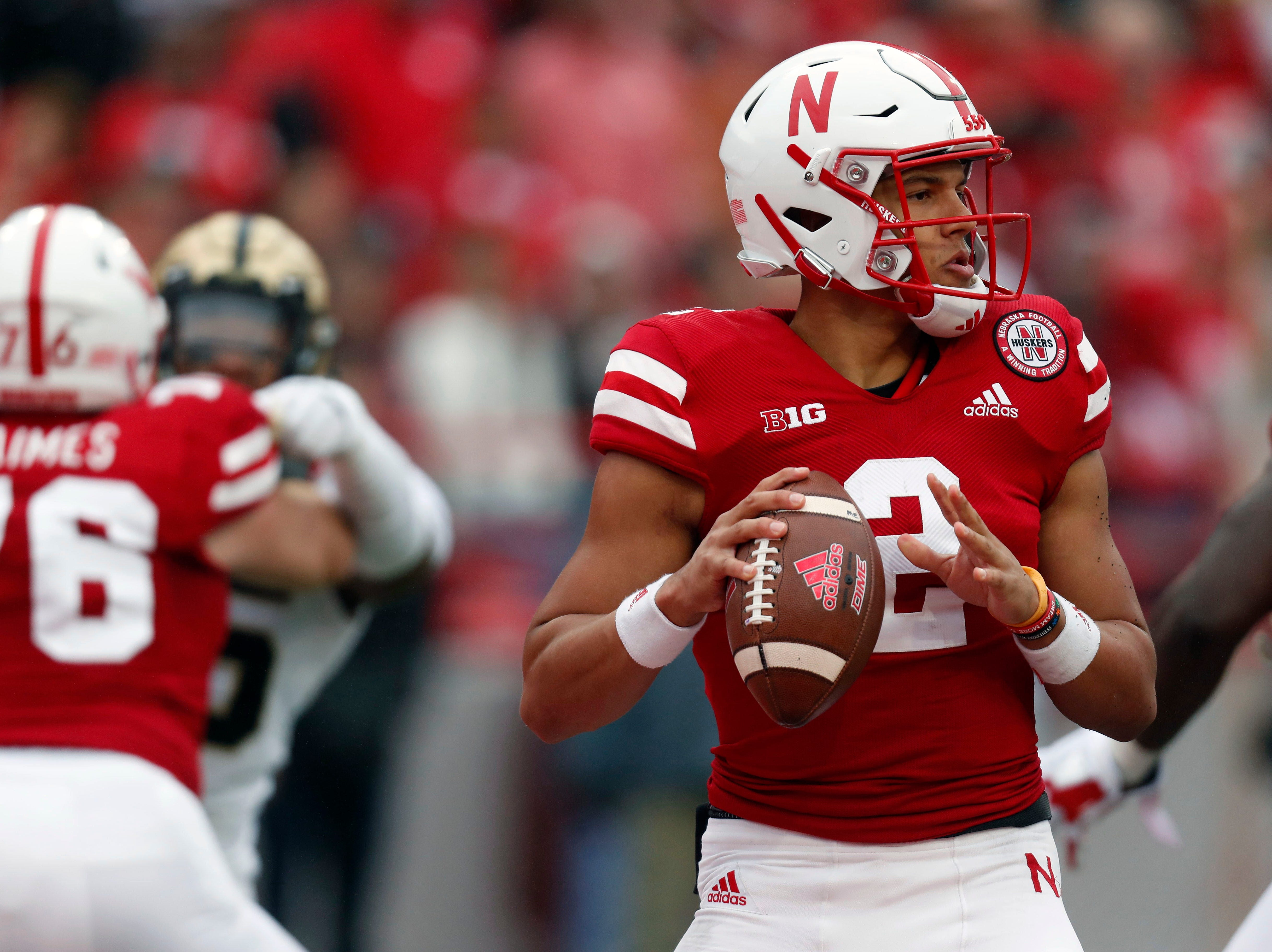 Sep 29, 2018; Lincoln, NE, USA; Nebraska Cornhuskers quarterback Adrian Martinez (2) looks to throw against the Purdue Boilermakers in the first half at Memorial Stadium. Mandatory Credit: Bruce Thorson-USA TODAY Sports