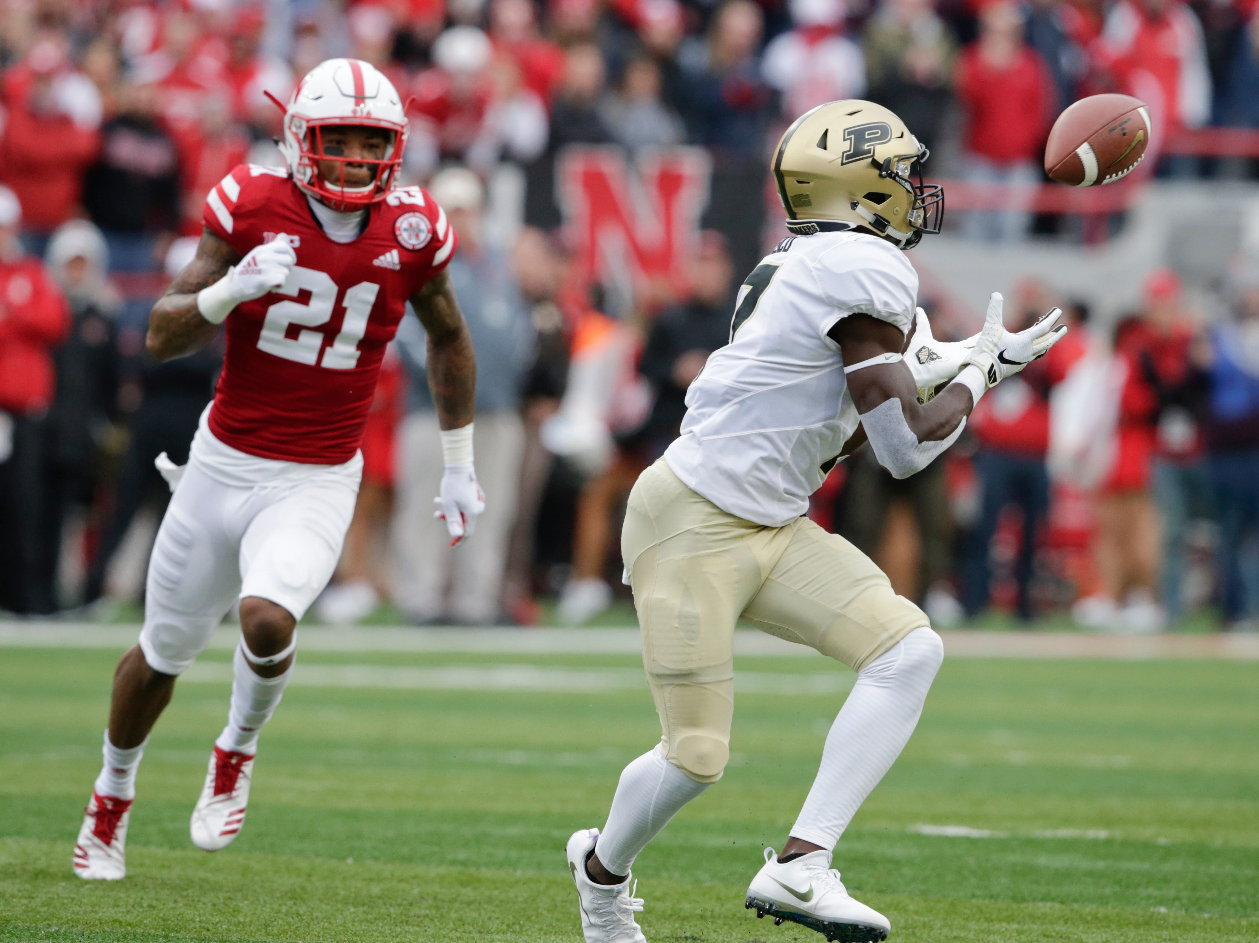 Purdue wide receiver Isaac Zico (7) makes a catch in front of Nebraska defensive back Lamar Jackson (21) during the first half of an NCAA college football game in Lincoln, Neb., Saturday, Sept. 29, 2018. (AP Photo/Nati Harnik)